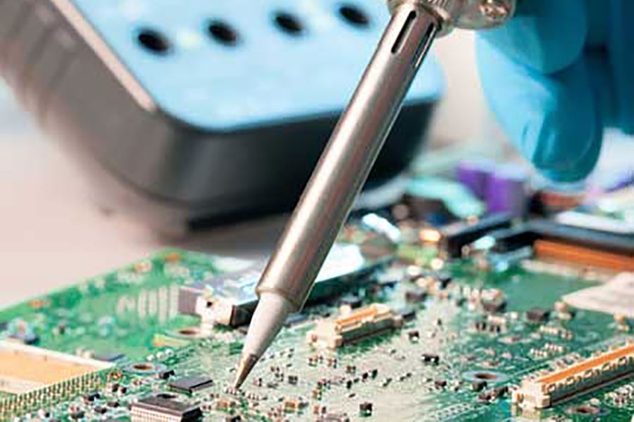 Plasma treatment, wire bonding - close up of a electronics board and soldering iron