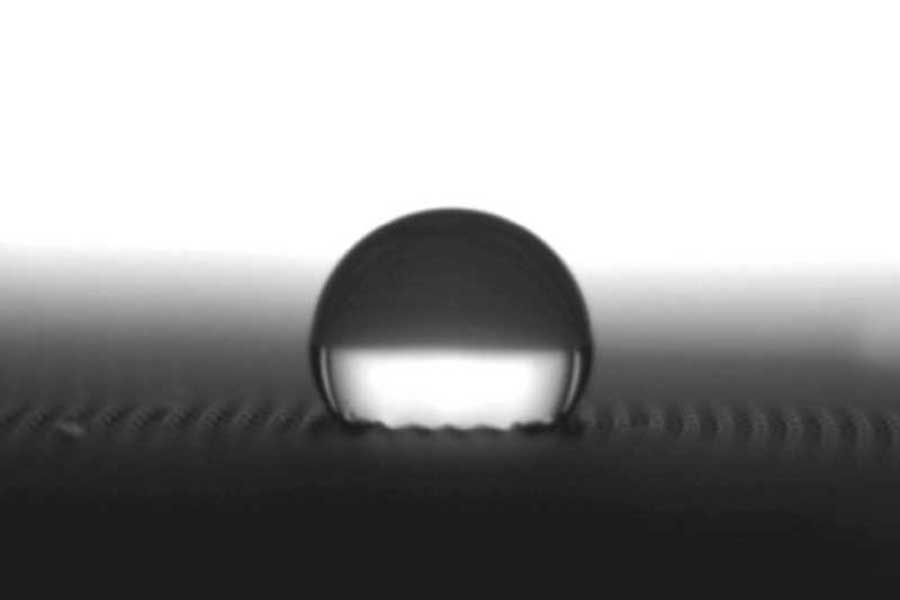 Adhesion and Surface Energy - image of henniker plasma product contact angle measurement droplet example